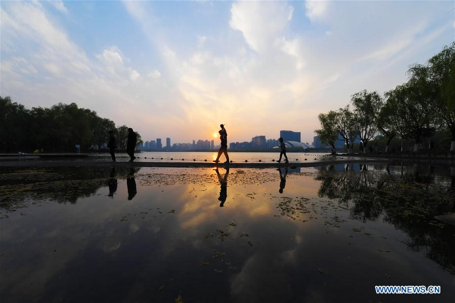 Tourists have fun by Swan Lake in Hefei, E China's Anhui