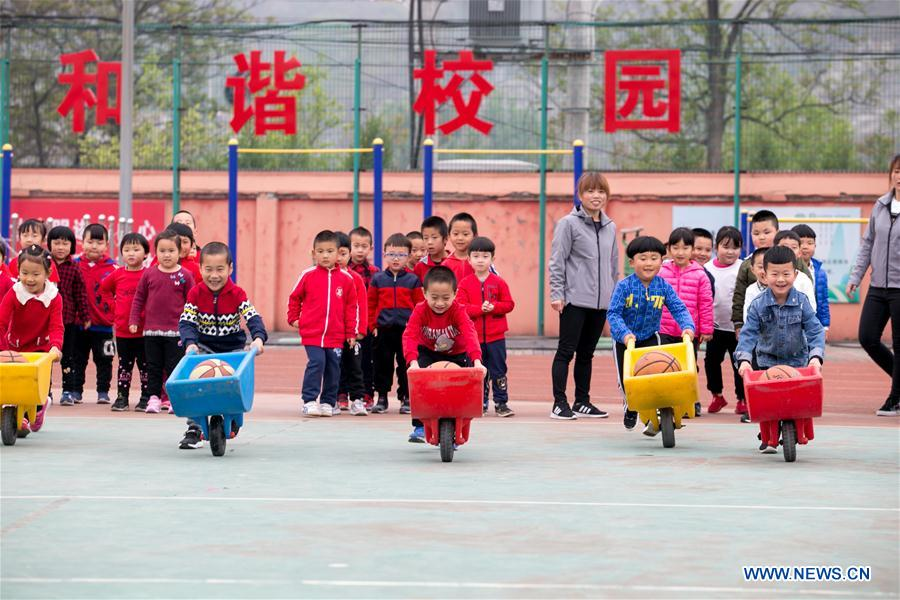 Children enjoy games with parents in kindergarten in Beijing