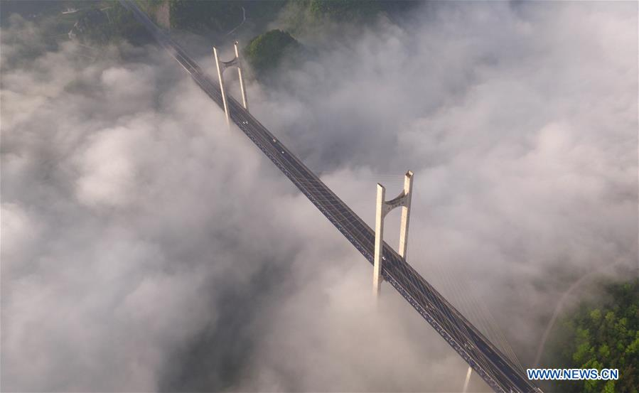 Aerial view of Gongshui River Bridge amid clouds and mists in China's Hubei