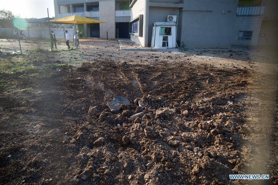 Aftermath of rocket attack in Kiryat Gat, Israel