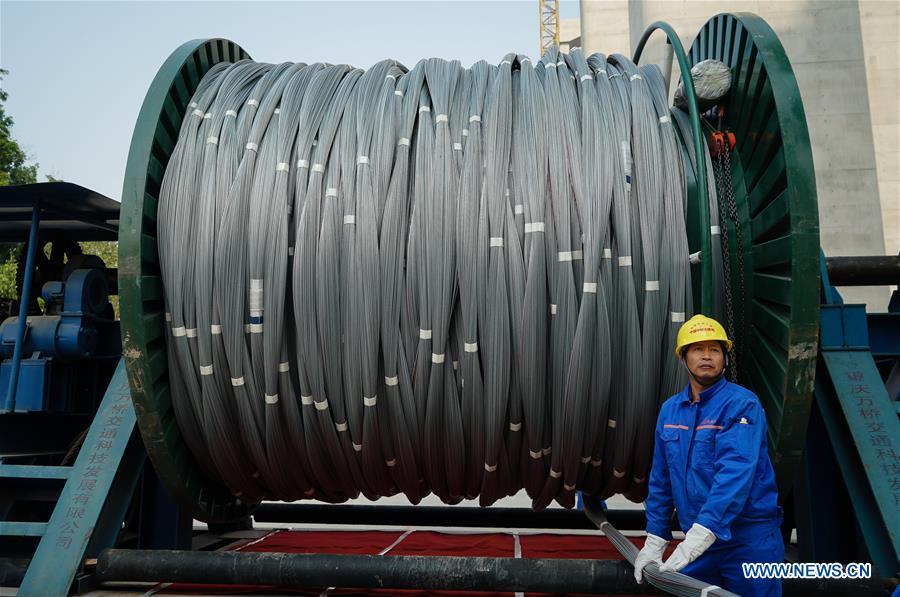 China's first road-rail suspension bridge's main cable rises