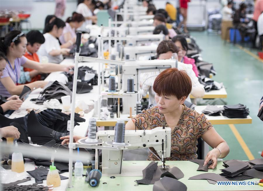 Poverty alleviation workshops established to help local residents get employed in central China