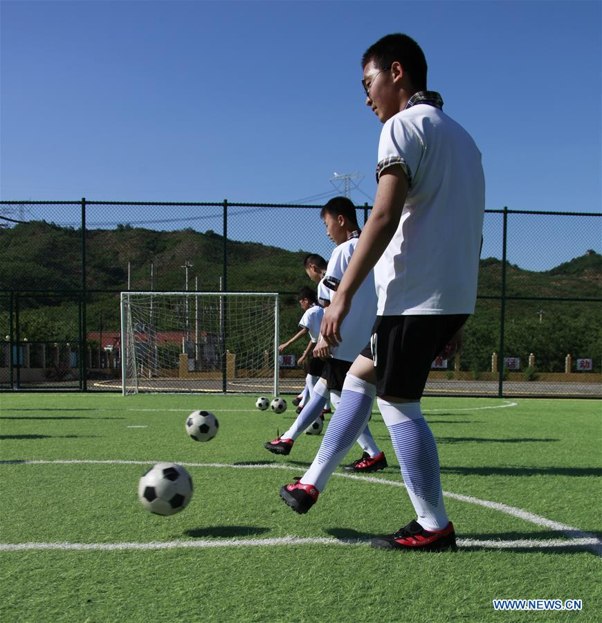 Students prepare for football match in China's Hebei