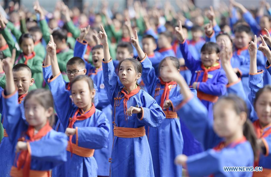 Students of Mongolian ethnic group practise traditional dances as way of exercises