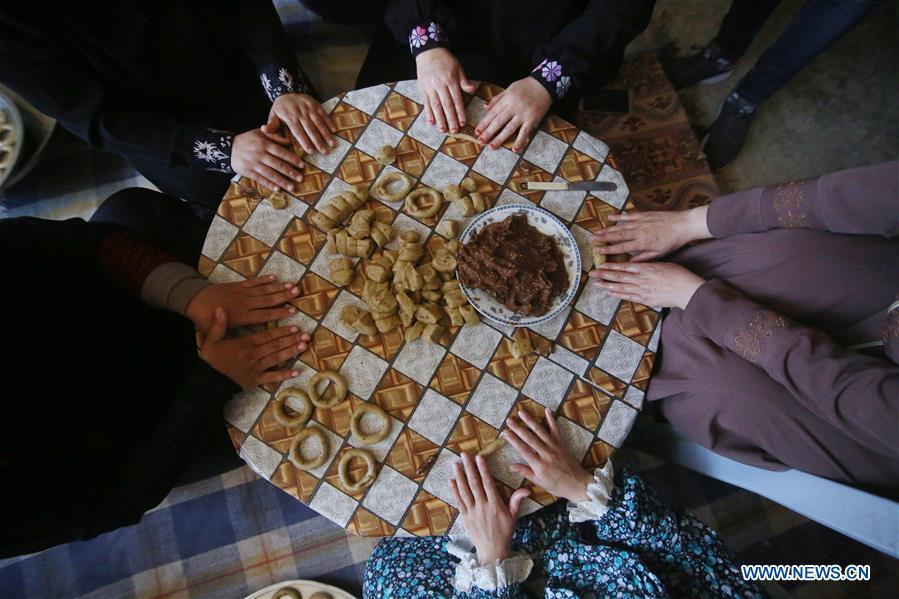 Palestinian people prepare traditional food ahead of Eid al-Fitr festivities in Rafah