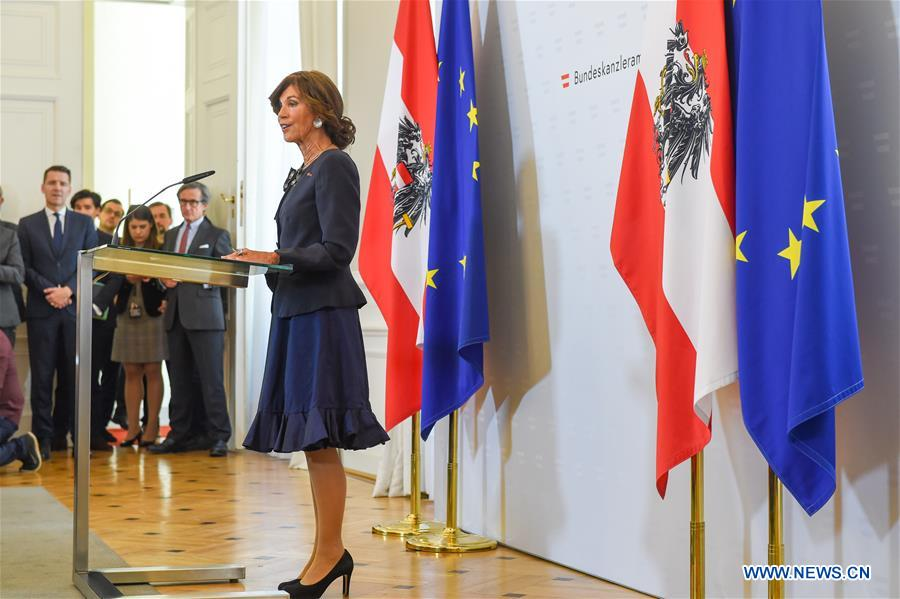 Former head of Austria's top court takes office as first female chancellor for the country
