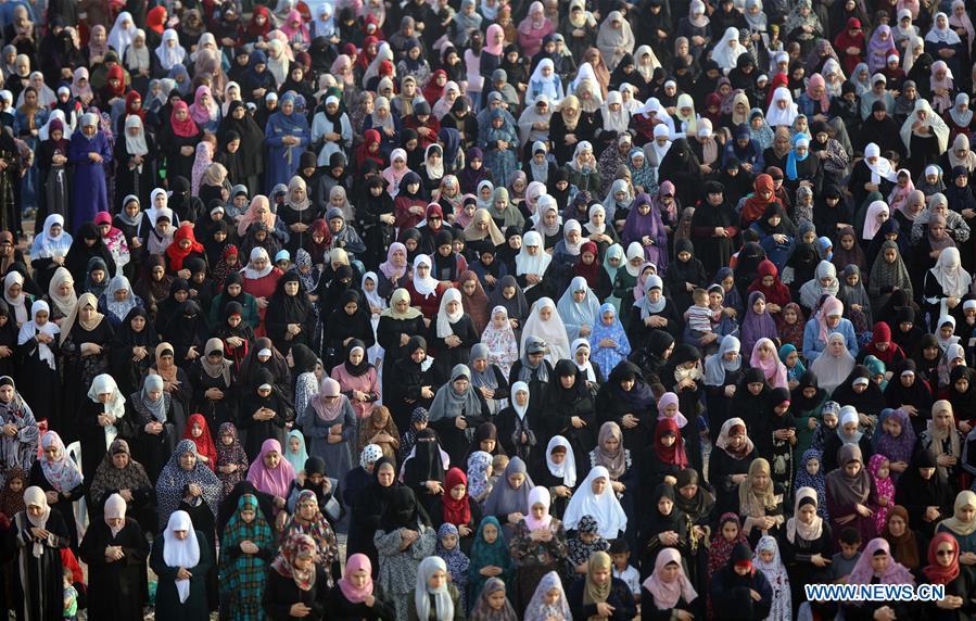 Muslims attend prayer to celebrate Eid al-Fitr around world