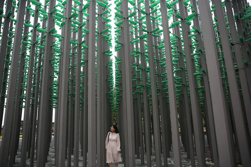 Walk into a forest made of beer bottles