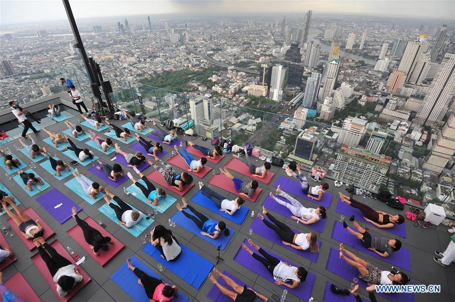 Yoga enthusiasts attend sunrise wine yoga class in Bangkok