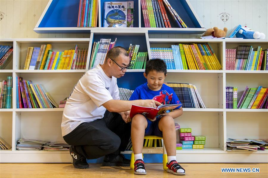 Children spend spare time in book stores during summer vocation