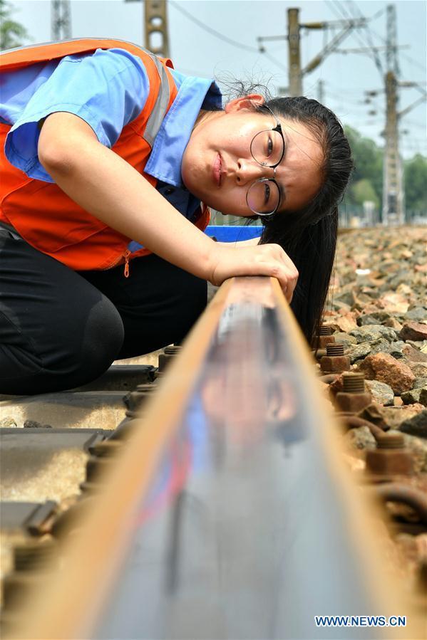 Patrol inspectors work along Daqin Railway to ensure transportation safety