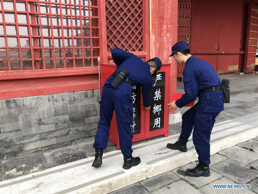 Fire fighters examine fire fighting equipments in Palace Museum