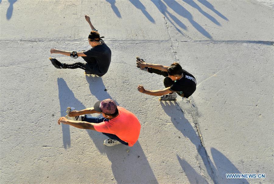 Palestinian boys roller-skate in Gaza City