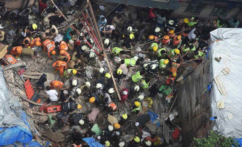 Seven killed, dozens trapped in building collapse in Mumbai
