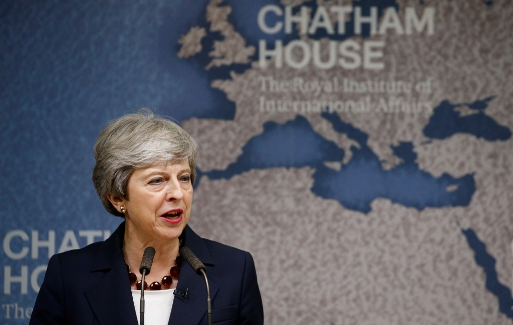 UK leader May slams populist politics, Brexit 'absolutism'