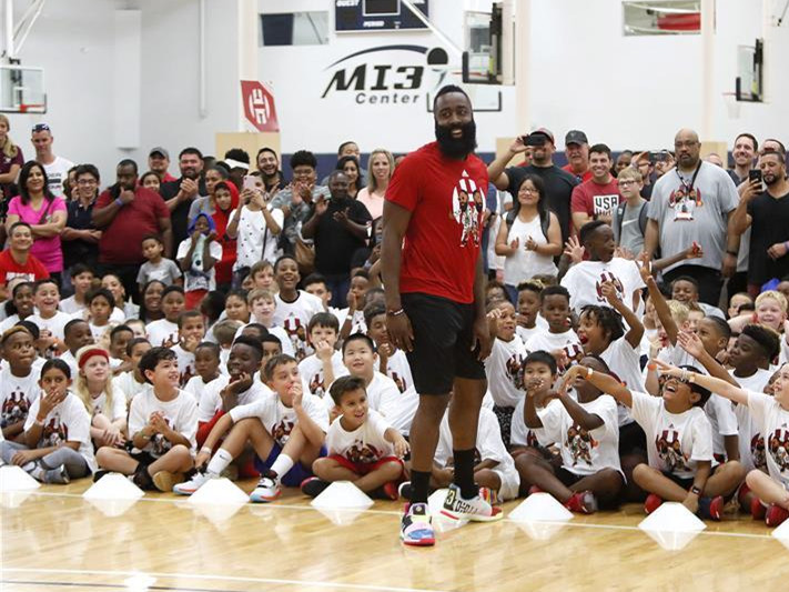 Harden plays with kids during basketball camp in Houston