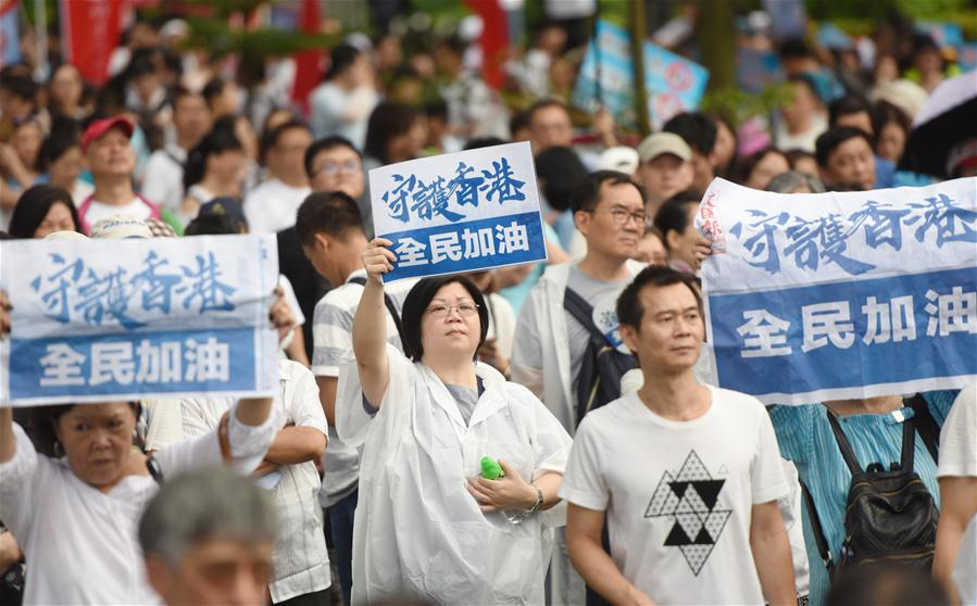 Residents of China's Hong Kong rally to appeal for peace, stability