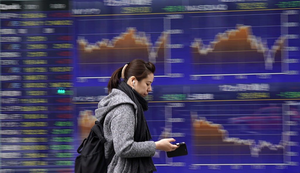 Tokyo stocks lose ground in morning tracking losses on Wall Street
