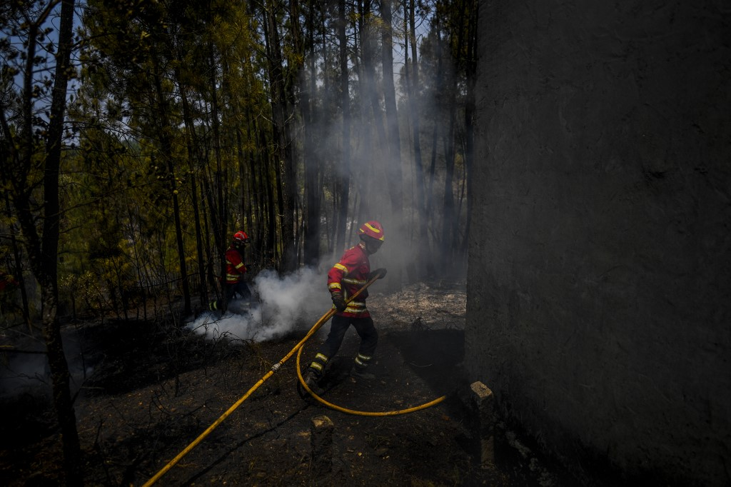 Portugal firefighters control wildfires, but warn of strong winds