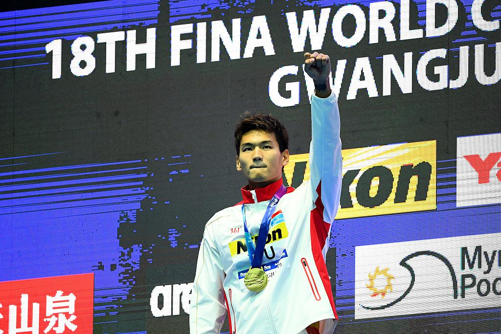 Xu Jiayu wins gold in men's 100m backstroke at FINA Worlds