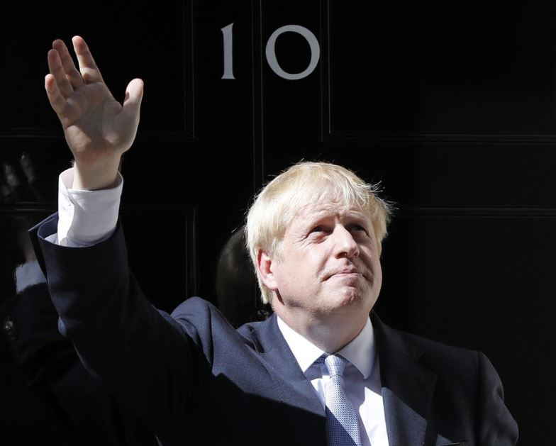 Boris Johnson becomes UK PM, aims to win over doubters