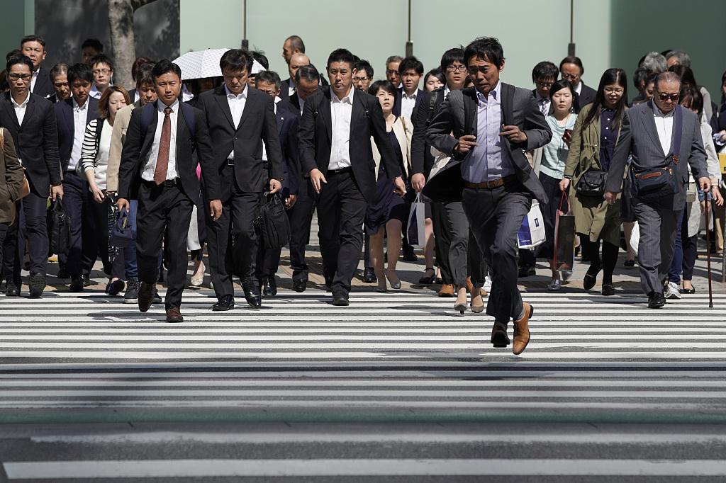 Tokyo stocks open lower on Wall Street's weak lead