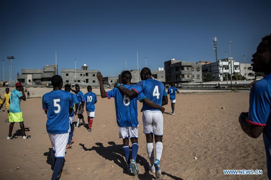 Migrants play football in Tripoli, Libya