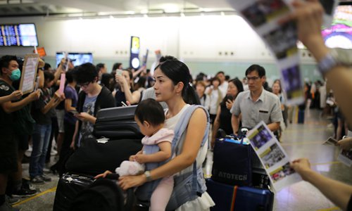 HK protesters obstruct international airport