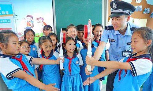 Senior CPC official stresses solving problems through education campaign