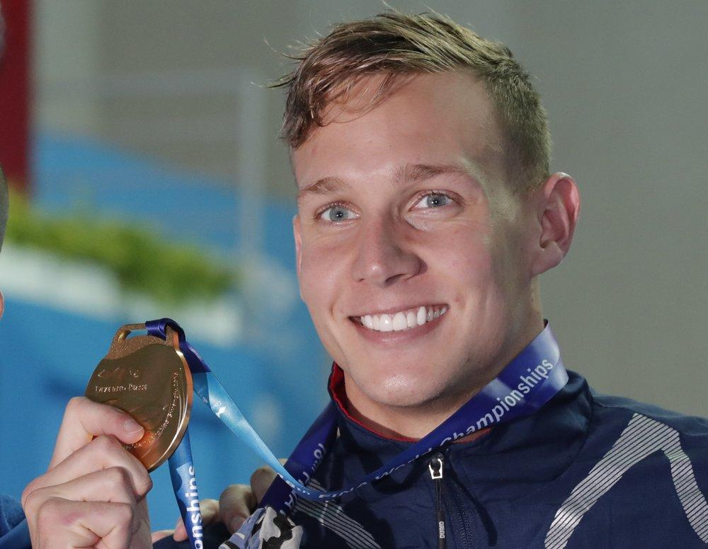 Gold rush: Dressel wins 3 titles in 1 night at swim worlds
