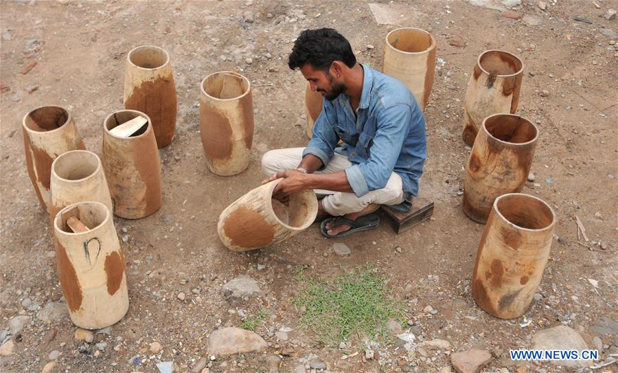 Craftsmen make traditional drums at slum area in Indian-controlled Kashmir
