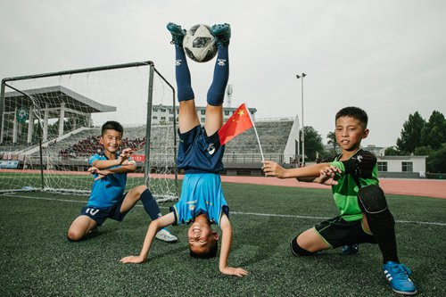 Shaolin martial arts school embraces campaign to promote soccer on campus