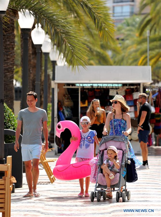 In pics: seaside in sweltering weather in Alicante, Spain