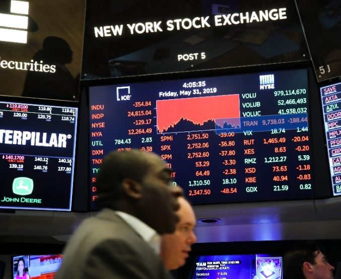 US stocks close mixed ahead of Fed's decision on rate cut