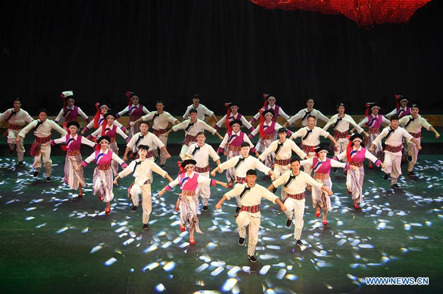 Actors perform at Gannan Grand Theatre in NW China's Gansu