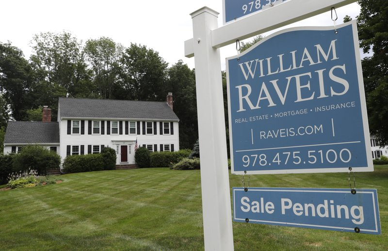 More Americans sign contracts to buy homes in June