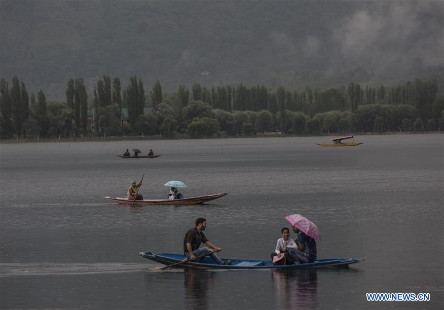 In pics: Indian-controlled Kashmir's Srinagar city in rain