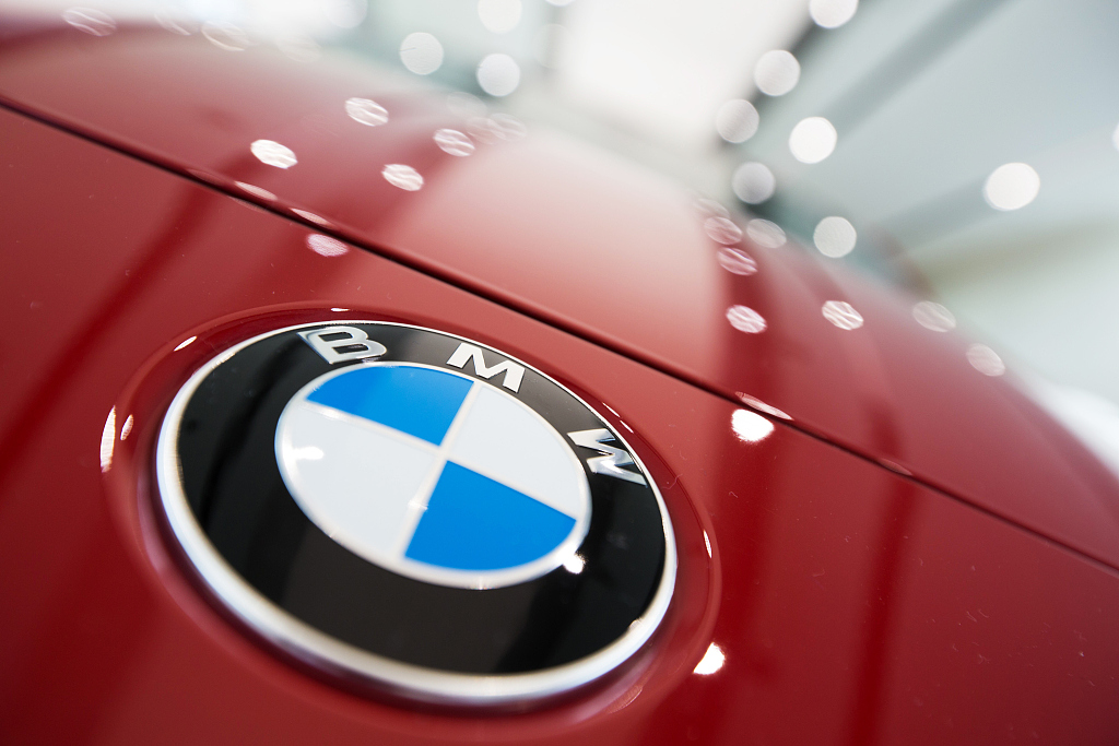 BMW profits dented by electric vehicle investment costs