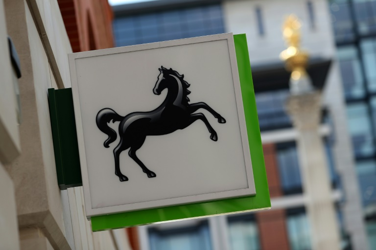 Britain's Lloyds banks lower profits on rising claims