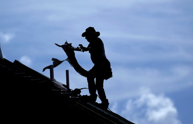 US worker annual compensation slows slightly through June