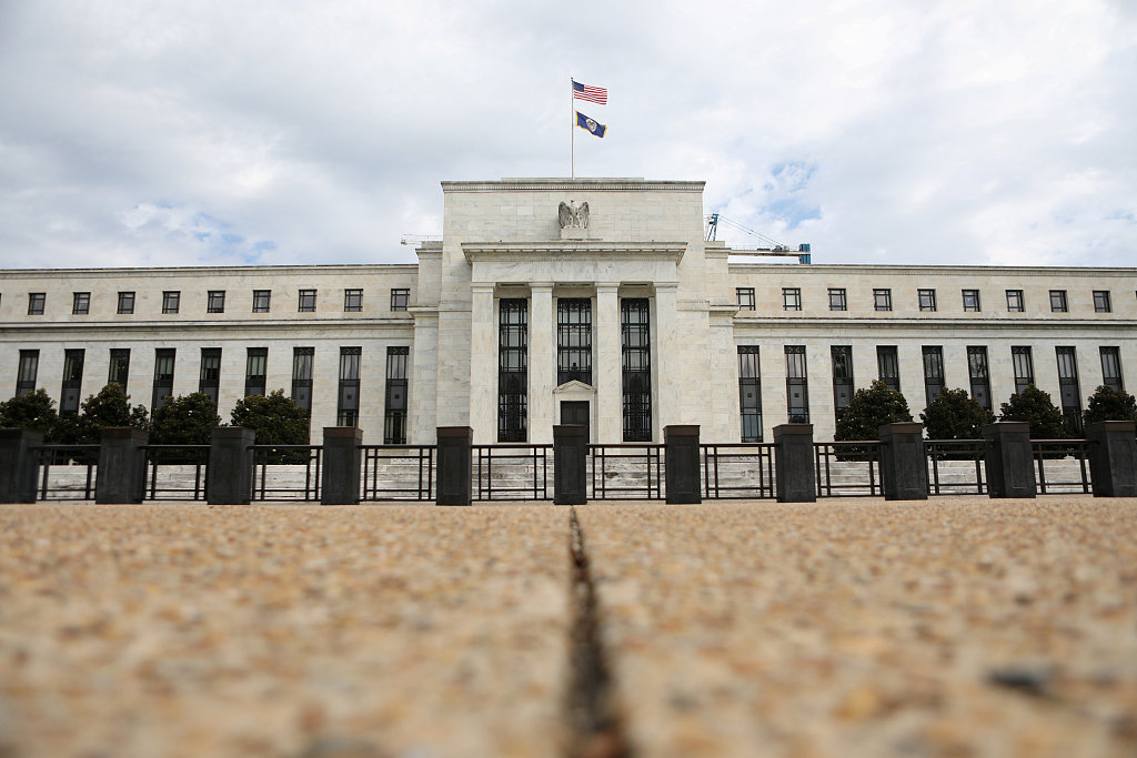 US Fed cuts key interest rate to 'insure' against global uncertainties
