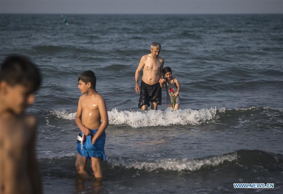 Locals enjoy leisure time in Ramsar city, Iran
