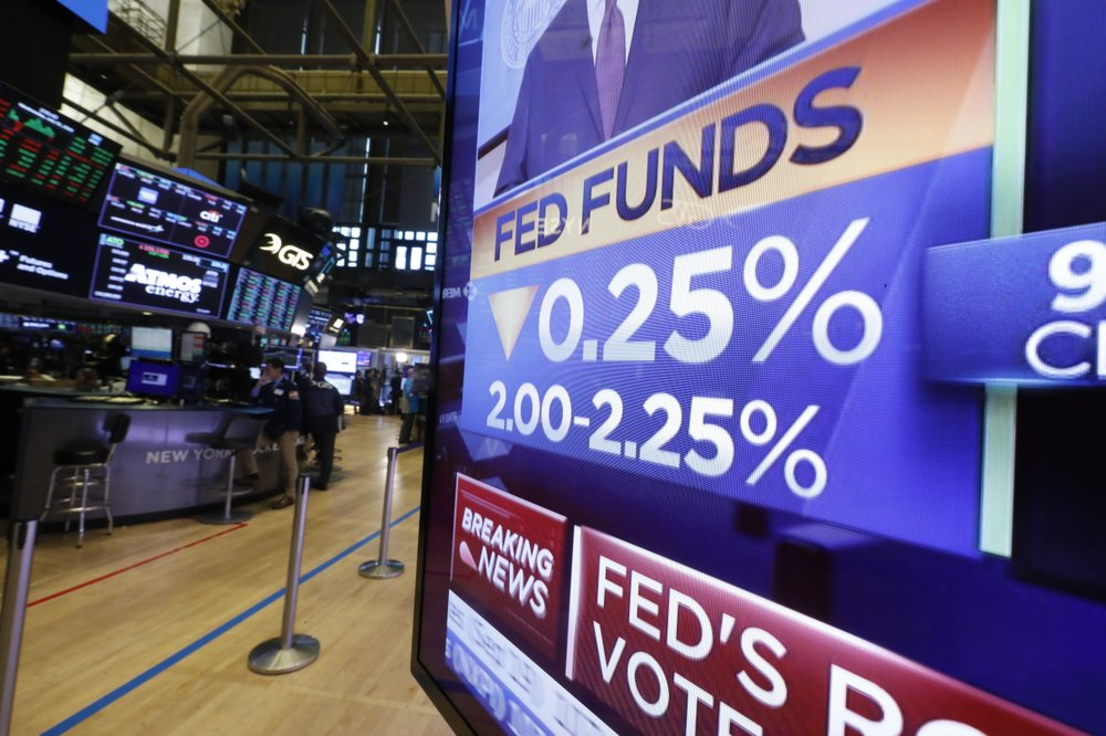US stocks close lower amid Fed's rate cut decision
