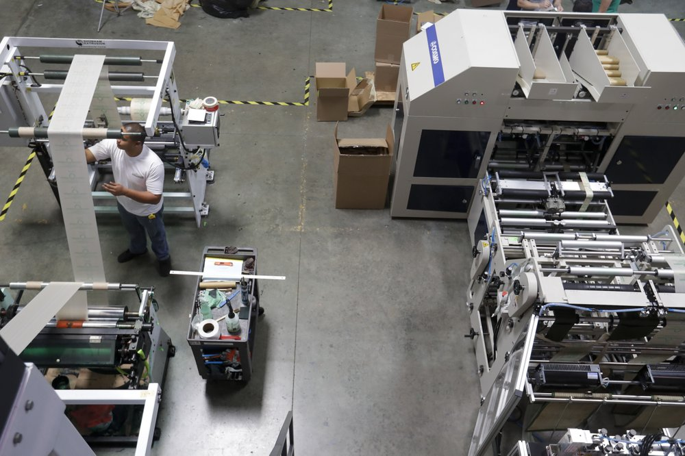 Survey: US manufacturing growth slows again in July