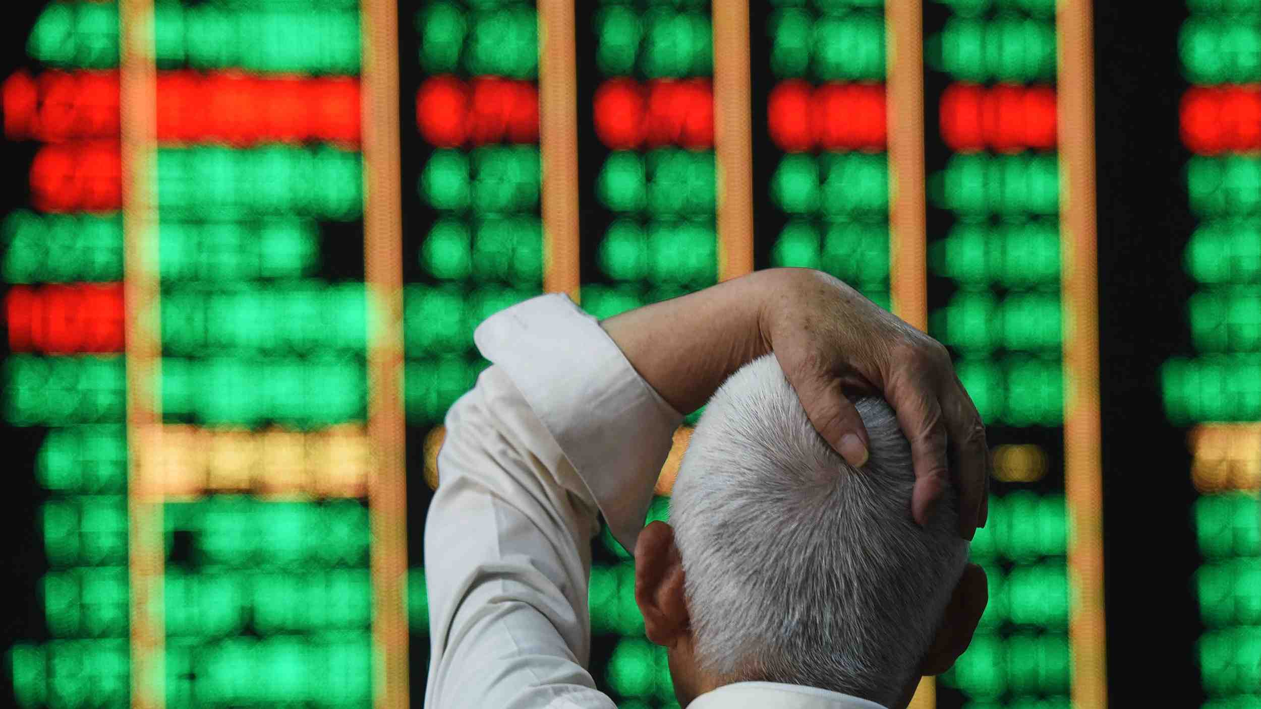 Chinese shares lower at midday Friday