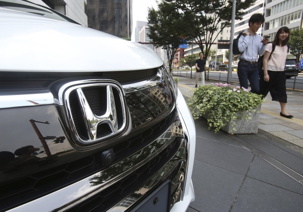 Toyota profits up, Honda's down, both lower annual forecasts