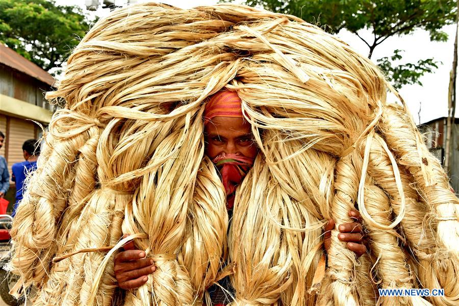 Farmers sell jute at wholesale market in Bangladesh