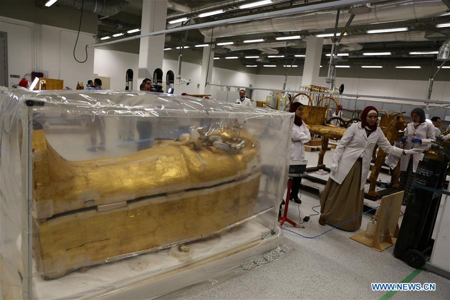 Egypt's restoration of ancient King Tut's large coffin goes well