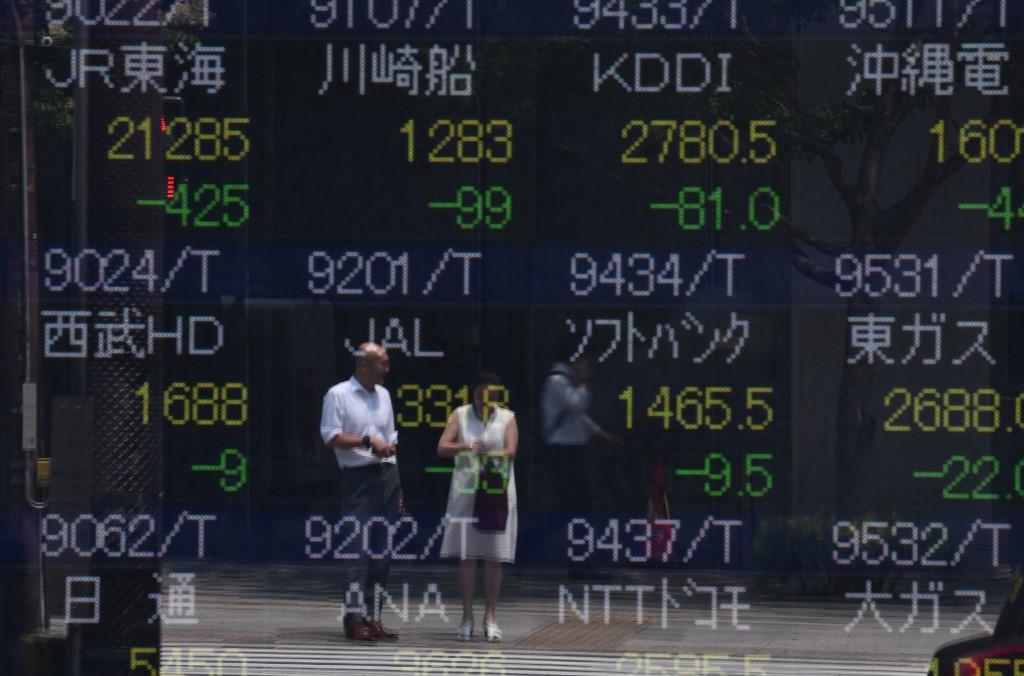 Tokyo stocks open lower as yen rises