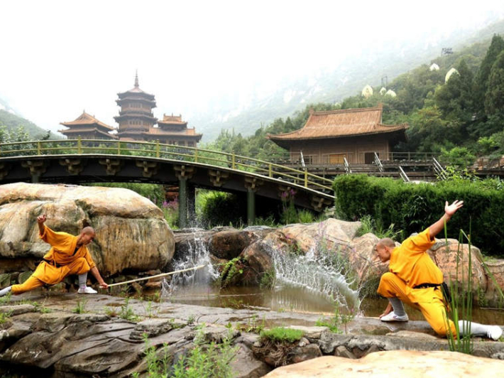 Shaolin monks practice kung fu in scorching heat